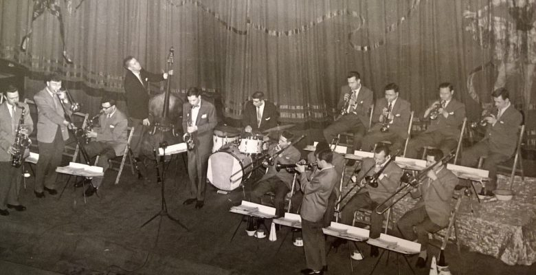 John Danworth and Band on stage with Comedia inspired House Tabs in situe