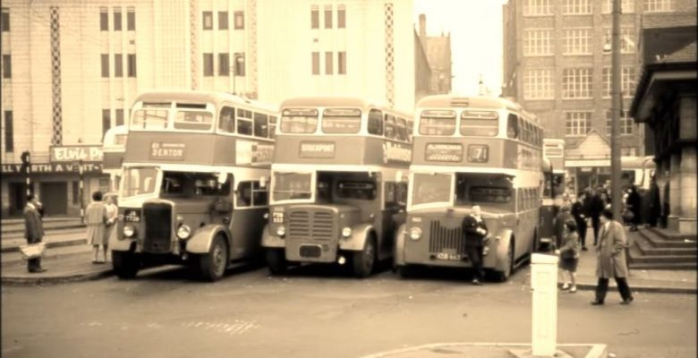 The Bus terminus with three classic buses awaiting their passengers with Elvis Presely appearing on screen at The Plaza